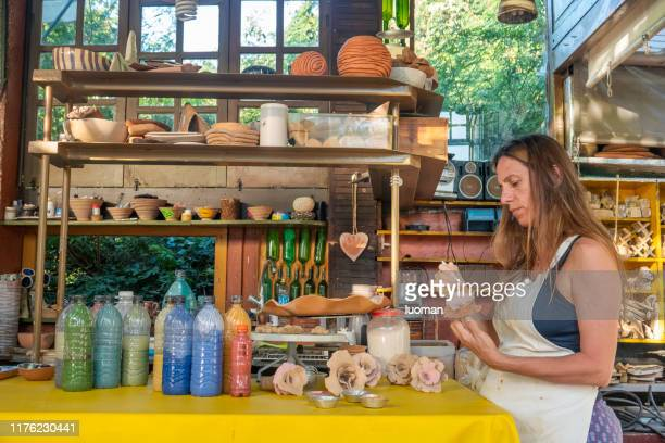 artist working in her atelier - craft product stock pictures, royalty-free photos & images
