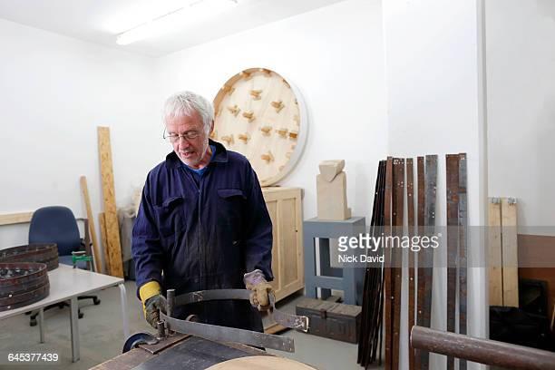 Artist working in his studio