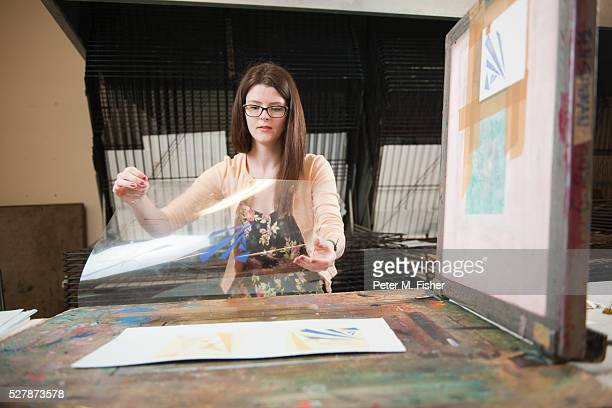 Artist working in printmaking studio