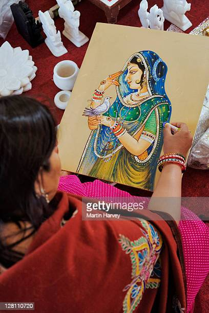 Artist working on drawing at the Udaipur School of Miniature Paintings. India.