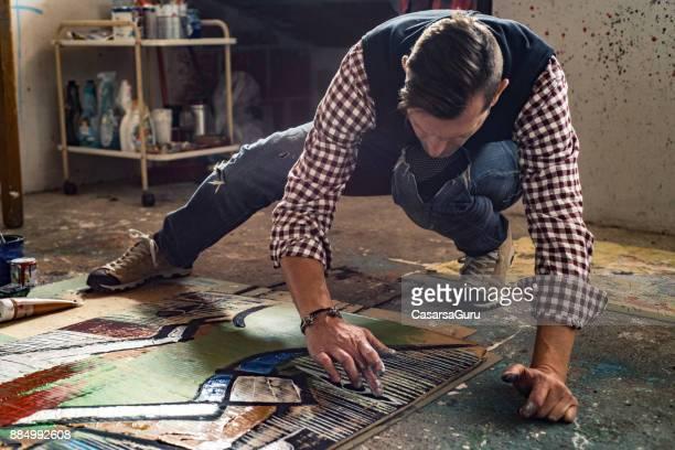 Artist Working On His Painting In Art Studio