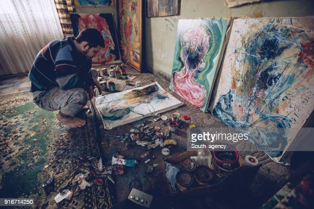 Artist working on painting