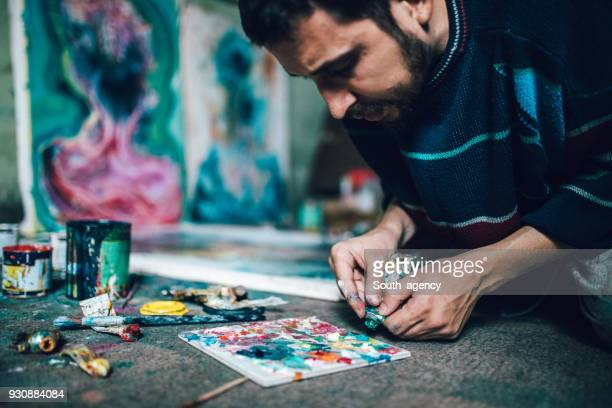 Artist working with colors