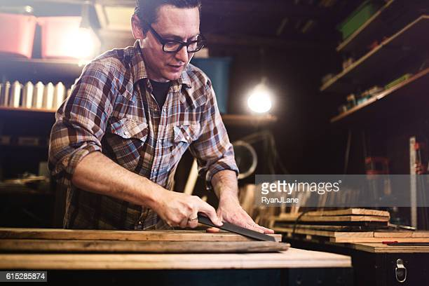 Artist Working With Wood in Studio