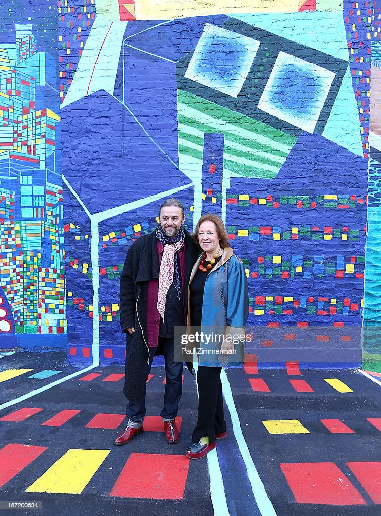 Artist Yanusz Gilewicz and Executive and Creative Director of CITYarts, Inc., Tsipi Ben-Haim attend the CityArts & Disney 'Celebrating The Heros Of Our City' Mural Ribbon Cutting at Henry M. Jackson Playground on November 6, 2013 in New York City.