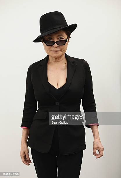 """Artist Yoko Ono arrives for a press conference ahead of the opening of her art installation """"Das Gift"""" at the Haunch of Venison gallery on September..."""
