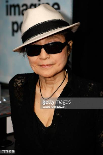Artist Yoko Ono stands inside the John Lennon Educational Tour Bus at the 2008 International Consumer Electronics Show at the Las Vegas Convention...