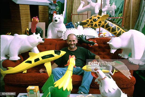Artist Yves Rizzio surrounded by his works in his studio