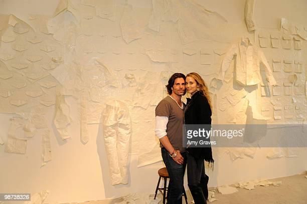 Artist/designer Greg Lauren and actress Elizabeth Berkley attend Greg Lauren Presents Alteration Art on April 28 2010 in Los Angeles California