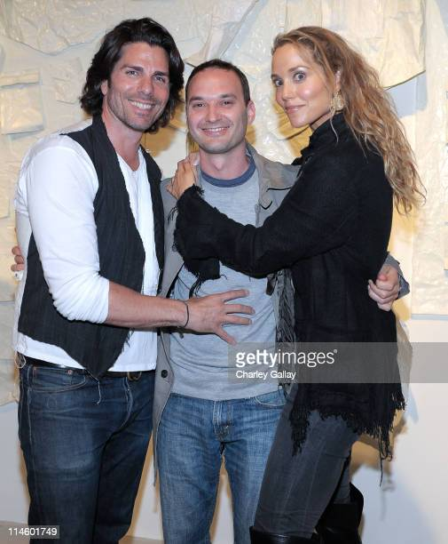 Artist/designer Greg Lauren photographer Jeff Vespa and actress Elizabeth Berkley attend the Los Angeles party for Alteration presented by Greg...