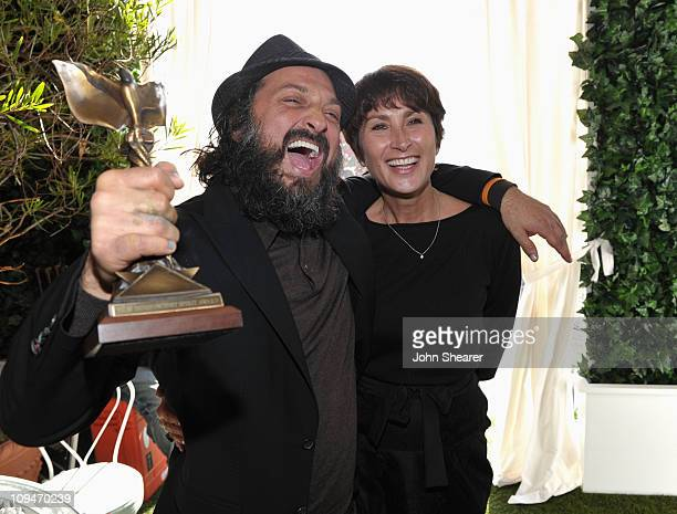 Artist/filmmaker Thierry Guetta winner of Best Documentary award for 'Exit Through the Gift Shop' and Piaget PR Manager Natacha Hertz in the Piaget...