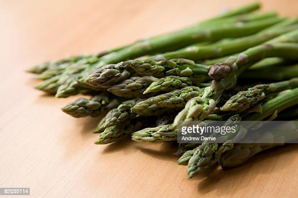 artistic asparagus shot on a wooden board, shallow depth of field. room for text on left. - andrew dernie stock pictures, royalty-free photos & images
