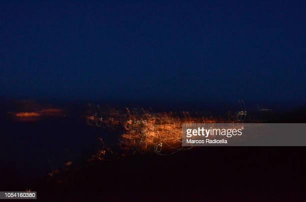 artistic city lights in patagonia - radicella bildbanksfoton och bilder