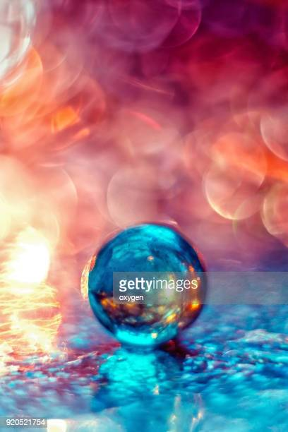 Artistic composition of blue and red glass ball with water drop