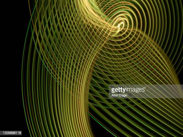 artistic creation forming concentric and curved dimension with a black background. - sound wave stock pictures, royalty-free photos & images
