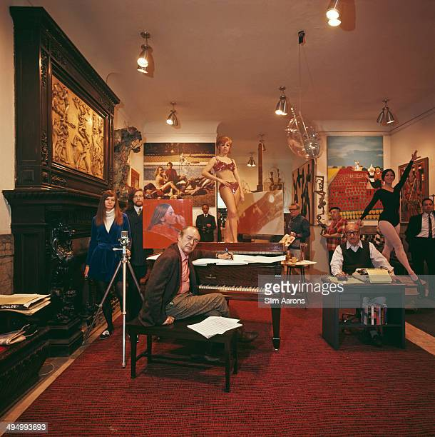Artistic denizens gather in the lobby of the Chelsea Hotel on W 23rd Street Manhattan New York City 1968 Clockwise from left photographer Sandy Daley...