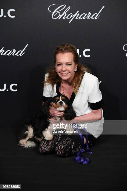Artistic Director and CoPresident of Chopard Caroline Scheufele and her dog attends the Chopard Gentleman's Night during the 71st annual Cannes Film...