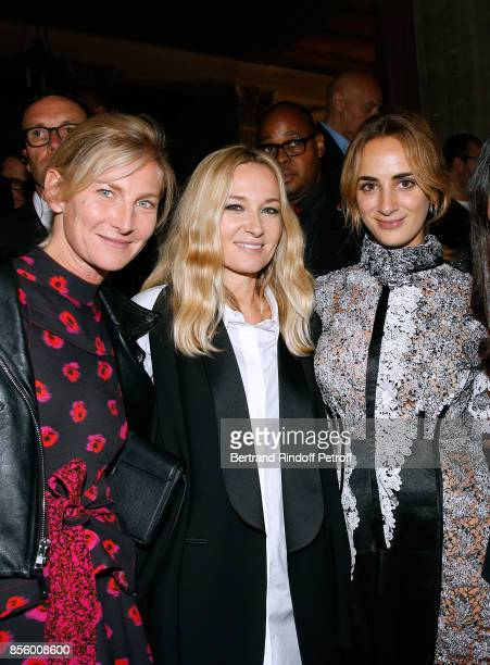 Artistic Director at Sonia Rykiel Julie de Libran standing between Elizabeth von Guttman and Alexia Niedzielski pose after the Sonia Rykiel show as...