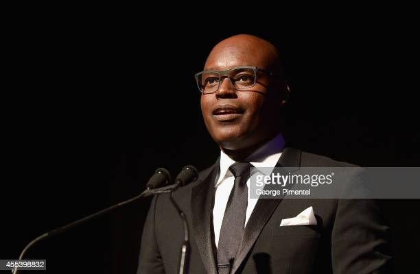 """Artistic Director Cameron Bailey speaks at the """"A Little Chaos"""" premiere introduction during the 2014 Toronto International Film Festival at Roy..."""