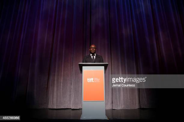 Artistic Director Cameron Bailey speaks onstage at the Escobar Paradise Lost premiere during the 2014 Toronto International Film Festival at Roy...