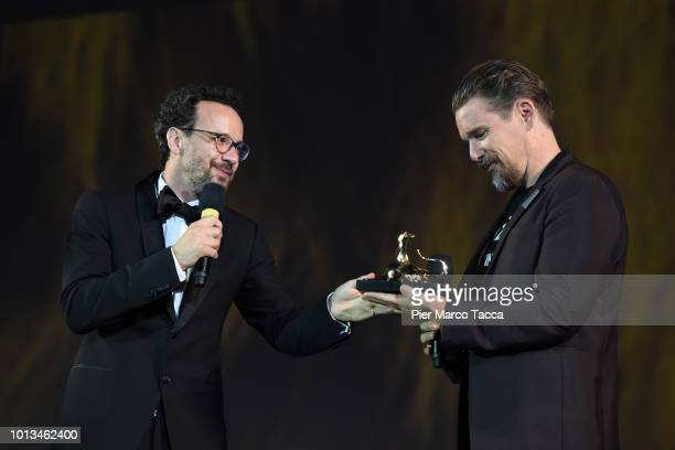 Artistic Director Carlo Chatrian presents the Excellence Award to actor/director Ethan Hawke during the 71st Locarno Film Festival on August 8 2018...
