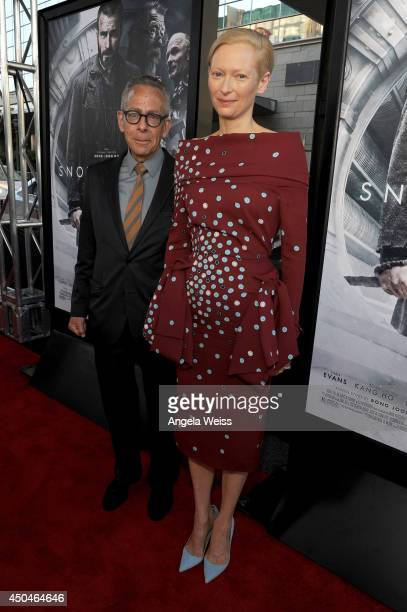 LAFF artistic director David Ansen and actress Tilda Swinton attend the opening night premiere of Snowpiercer during the 2014 Los Angeles Film...