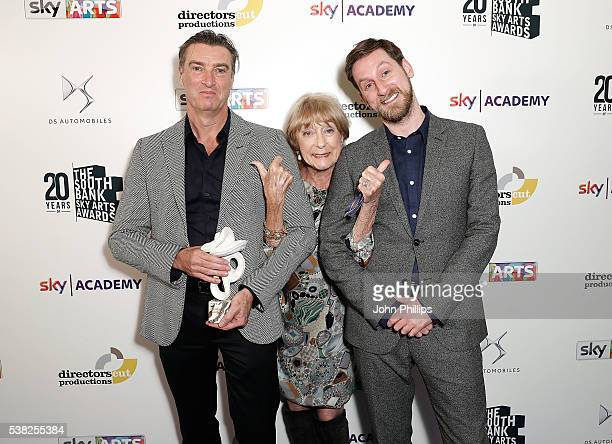 Artistic director David Nixon and choreographer Jonathan Watkins accepting the Best Dance award pose with Dame Gillian Lynne at the The South Bank...