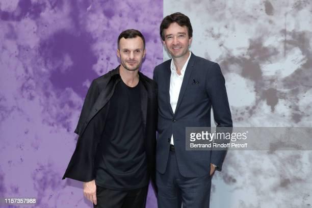 Artistic Director of Berluti Kris Van Assche and General manager of Berluti Antoine Arnault pose after the Berluti Menswear Spring Summer 2020 show...