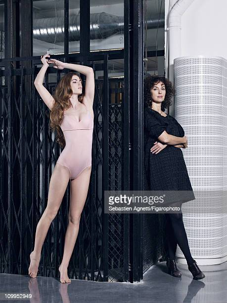 Artistic director of Eres, Valerie Desfosses poses with a model at a fashion shoot for Madame Figaro on January 12, 2011 in Paris, France. Published...