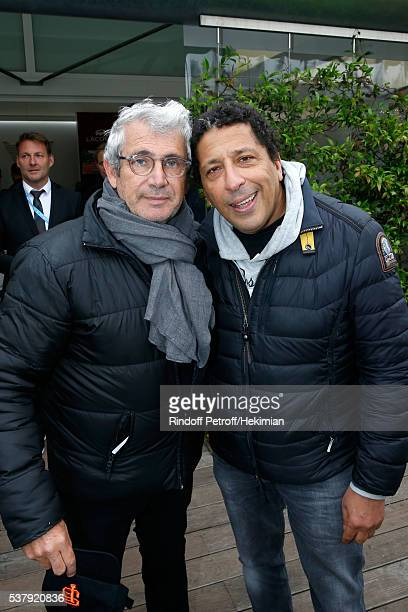 Artistic Director of Ramatuelle Festival Michel Boujenah and actor Smain attend Day Thirteen of the 2016 French Tennis Open at Roland Garros on June...