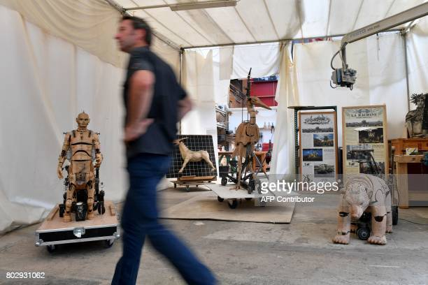 Artistic director of the company 'La Machine' Francois Delaroziere walks on June 20 in the Machine workshop in the nave of 'Les Machines de L'Ile' in...