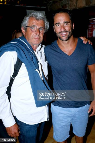 Artistic Director of the Festival Michel Boujenah and humorist Florent Peyre pose backstage after the show of the 30th Ramatuelle Festival Day 11 on...