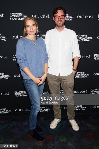 Artistic Director of the Hamptons International Film Festival David Nugent and Director Alexis Bloom attend the photo call for Divide and Conquer at...