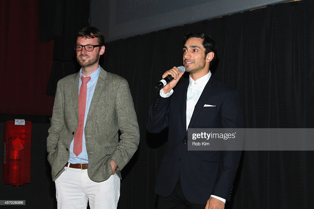 Artistic Director of the Hamptons International Film Festival David Nugent (L) and actor Riz Ahmed speak at the 'Nightcrawler' premiere during the 2014 Hamptons International Film Festival on October 10, 2014 in East Hampton, New York.