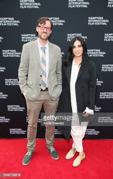 Artistic Director to Hamptons International Film Festival David Nugent director Nadine Labaki attend the photo call for Capernaum at UA East Hampton...