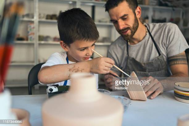 artistic family working with clay - pottery stock pictures, royalty-free photos & images