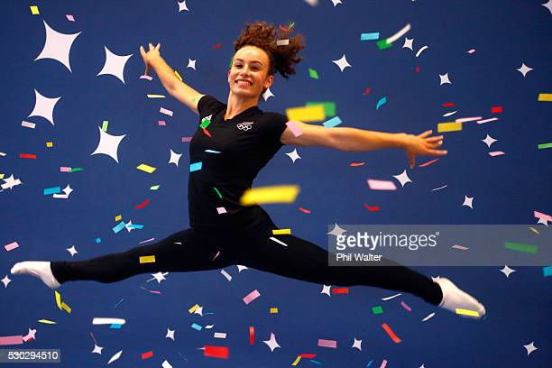 Artistic gymnast Courtney McGregor leaps with a confetti canon during the NZOC New Zealand GymSports Announcement at Tri Star Gymnastics on May 11...