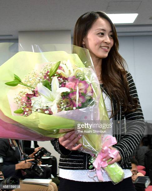 Artistic Gymnast Rie Tanaka leaves after a press conference on her retirement at Nippon Sports Science University on December 19 2013 in Tokyo Japan