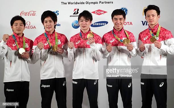 Artistic Gymnastics Men's Team Gold medalists Koji Yamamuro Ryohei Kato Kohei Uchimura Kenzo Shirai and Yusuke Tanaka of Japan pose for photographs...