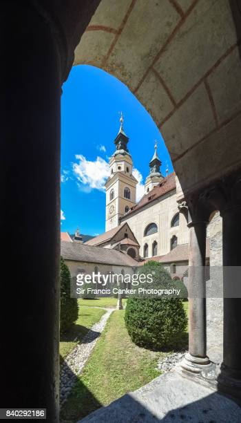 Artistic image of Brixen cathedral seen from old Romanesque cloister in South Tyrol, Italy