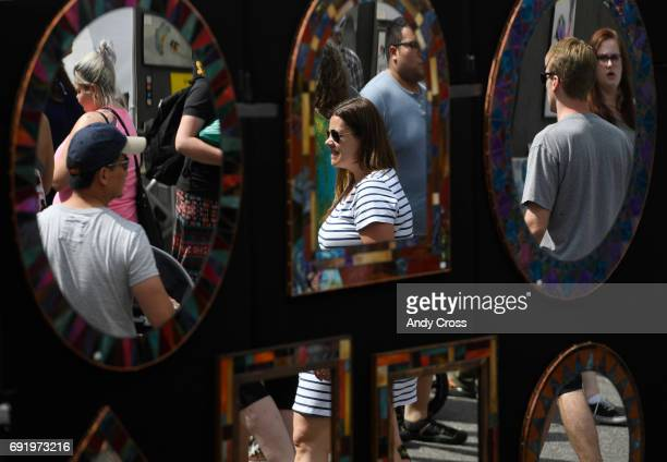 Artistic mirrors from Mountain Mosaics in Conifer Colorado at the annual People's Fair at Civic Center Park June 03 2017 in Denver The People's Fair...