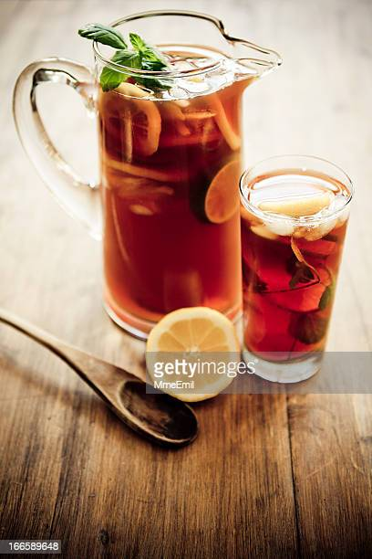 Artistic photo of a pitcher and glass of iced tea