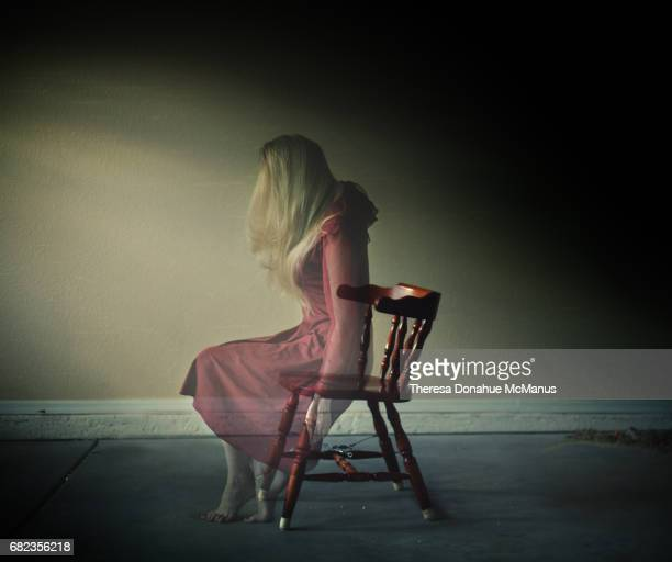 Artistic photo of woman in wooden chair