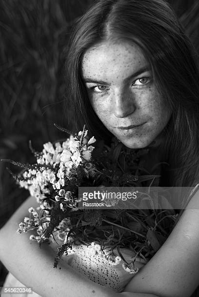 artistic portrait of freckled woman