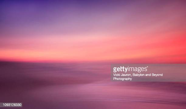 artistic soft pink and purples at sunrise at jones beach, long island. - spirituality photos et images de collection