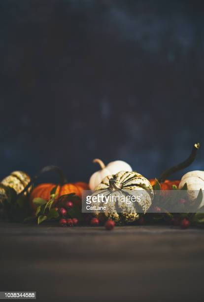 Artistic still life fall background with rustic wood and pumpkins