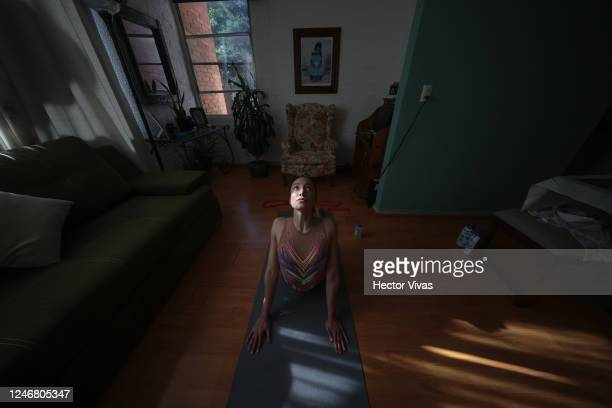 Artistic swimmer Regina Alferez performs exercises as part of a training session at home on June 05 2020 in Mexico City Mexico Despite the 'Healthy...