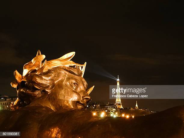 CONTENT] Artistic view of the Eiffel Tower as seen from behind the central Nymph of the Pont Alexandre III bridge both illuminated at night The...