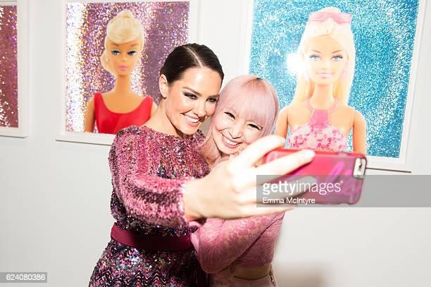 Artist/model Beau Dunn and Azusa Sakamoto aka 'Azusa Barbie' attend Beau Dunn's 'Plastic' opening at De Re Gallery on November 17 2016 in West...