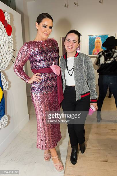 Artist/model Beau Dunn and singer/songwriter Madeline Fuhrman attend 'Beau Dunn's 'Plastic' opening at De Re Gallery on November 17 2016 in West...